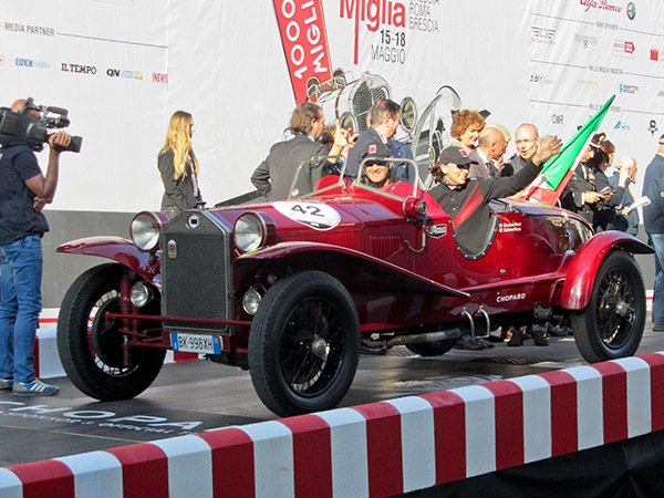 The 2014 Mille Miglia winners at the start to reclaim their 2011 title, Giordano Mozzi and Stefania Biacca driving an original Mille Miglia car, the 1928 Lancia Lambda tipo 221 spider Ca.Sa.Ro.
