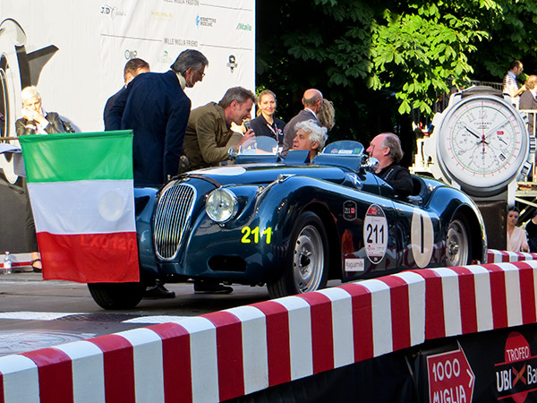 Jay Leno and Ian Cullum at the start in a 1951 XK120 Sports Ecurie Ecosse