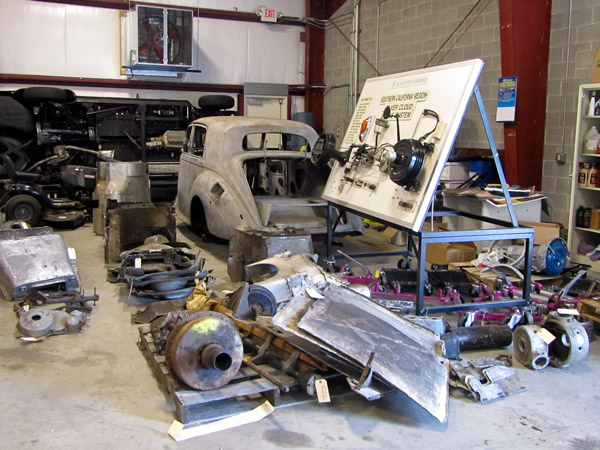 A glimpse at the many Rolls-Royce parts waiting to be catalogued within the restoration facility.