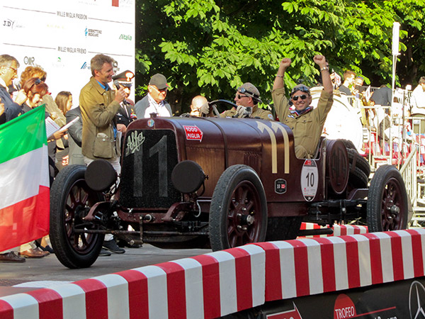 On the lawn at Pebble Beach in 2013 to the start of the 2014 Mille Miglia, Tony Shooshani is all smiles in his 1921 Alfa Romeo G1 with driver Craig Calder.