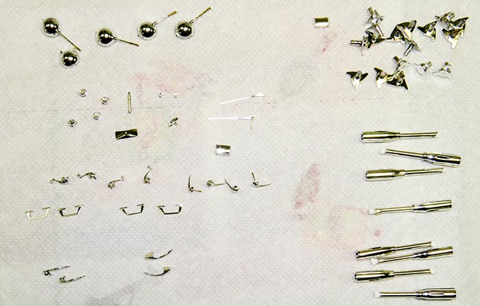 Closeup of small parts for a model car Ferrari 250 SWB, by Marshall Buck