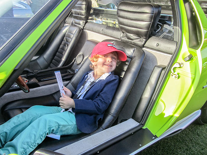 Youngest junior judge takes a break in the 1968 Lamborghini Miura, by Sandy Cotterman, Amelia Island Concours