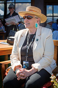 Denise McCluggage, smiling over her beloved Santa Fe Concorso