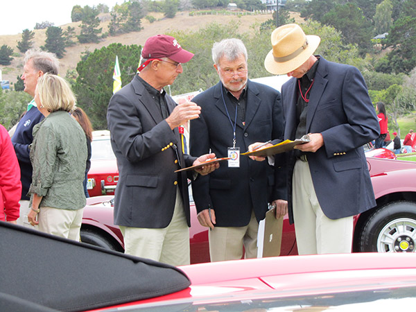 Conferring at Concorso Italiano. Photo by Ralf Berthiez