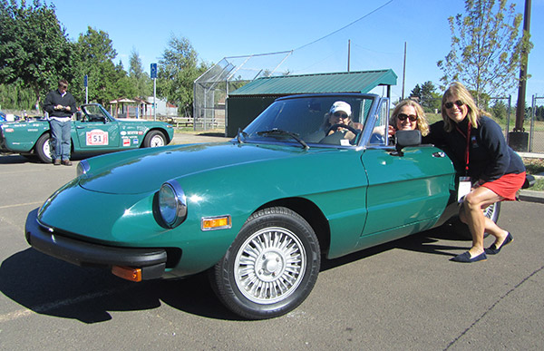 Sandy joins friends Cindy Banzer and Sue Halton of Portland, for a photo next to their 1978 Alfa Romeo Spider 2000.