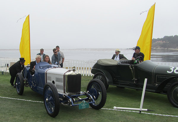 George Wingard, collector of prewar racing cars, heading out to the awards stand on Sunday!