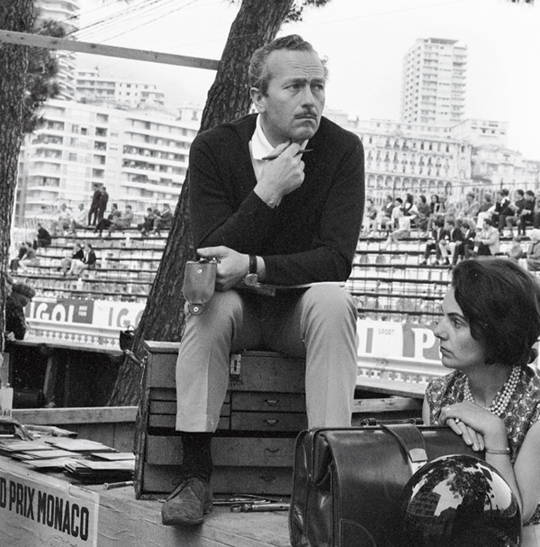 Lotus founder Colin Chapman and his wife Hazel during practice for the Monaco Grand Prix in 1964.