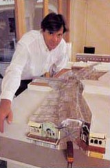John Britten with a model of the Cathedral Junction project