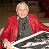 Denise McCluggage autographs enlargements of her best photos