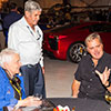 Denise McCluggage discussing events with Al Unser and Eddie Cheever at the Santa Fe Concorso Friday Night planes and cars event